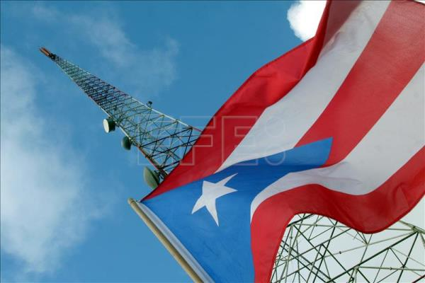 A Puerto Rican flag flies at a communications tower. EFE/File