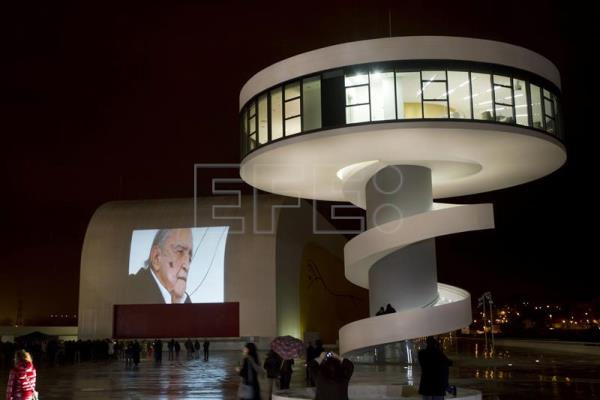 A file photo dated Dec. 7, 2012 shows images of Niemeyer projected onto the Oscar Niemeyer International Cultural Center in Aviles, Spain. EFE/Alberto Morante