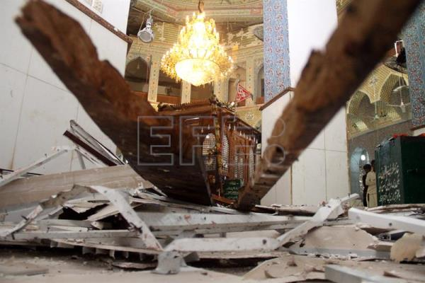 A view of damage caused at the compound surrounding the grave of Sufi Muslim Saint Lal Shahbaz Qalander after a suicide bomb attack in Sehwan, Pakistan, 17 February 2017.  EPA/NADEEM KHAWER