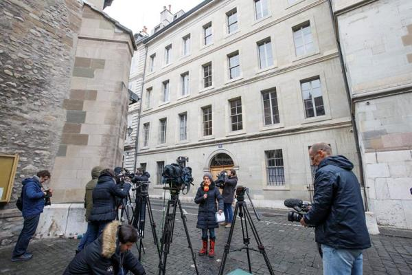 Journalists wait outside the residence of Spain's Cristina de Borbon, sister of Spain's King Felipe VI, and her husband Inaki Urdangarin, in Geneva, Switzerland, Friday, Feb. 17.  EPA/SALVATORE DI NOLFI