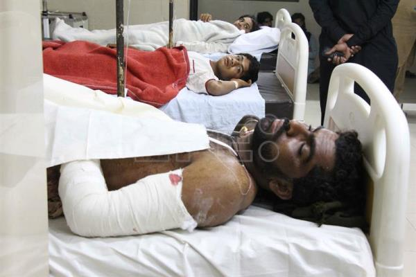 People who were injured in a suicide bomb attack that targeted the shrine of Sufi Muslim saint Lal Shahbaz Qalandar, receive medical treatment after they were transported to a hospital in Nawab Shah, Pakistan, 17 February 2017.  EPA/WAQAR HUSSAIN