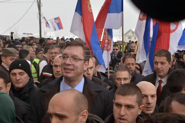 (File) Archive image dated Jan. 2015 showing  Serbian Prime Minister Aleksandar Vucic (C, with glasses) meeting ethnic Serbs at the village of Pasjan, Kosovo.    The EC appealed on Monday to Serbia and Kosovo to increase their judicial and law enforcement support to speed up the case of Kosovo's ex-prime minister Haradinaj, currently under arrest in France and awaiting a court's decision regarding his eventual extradition to Belgrade. EPA/STRINGER