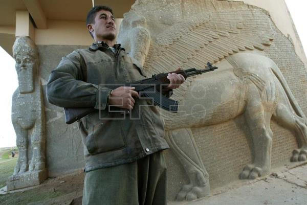 (FILE) Archive image dated Dec. 2003 showing a security guard posing in front of a wall carving at the Palace of Nimrod.  Iraqi armed forces liberated on Sunday the city of Nimrod, located some 30 kilometres (19 m) southeast of Mosul, within the overall military operations aimed at liberating Mosul, according to Iraqi Special Forces Chief Commander, Brigadier General Abdul Amir Yarallah. In the vicinity of modern-day Nineveh stands the ancient Assyrian city of Nimrod, which in 2014 was plundered, ransacked and demolished with bulldozers by IS Jihadists.