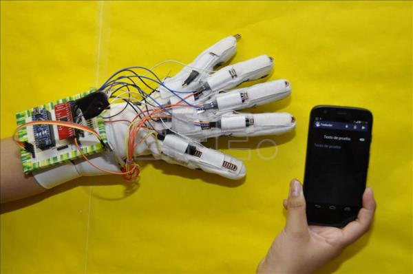 Photo provided by the National Polytechnic Institute of Mexico shows the a glove that translates text and sign languages to facilitate conversation between deaf and mute people. EFE / IPN