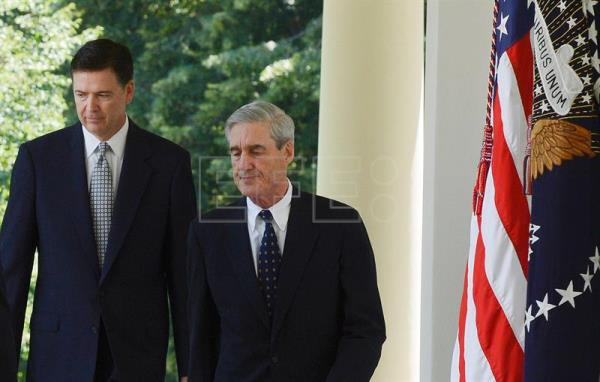 File photo showing former FBI director and then nominee James Comey (L) walks together with his then predecessor, former FBI Director Robert Mueller (R), in the Rose Garden of the White House in Washington DC, USA, 21 June 2013. EPA/MICHAEL REYNOLDS