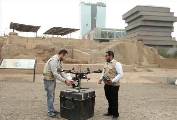 Members of the Peruvian Culture Ministry's aerial registration team inspect a drone at an archaeological site in Lima's San Borja district on Wednesday, Aug. 12, 2015. EFE