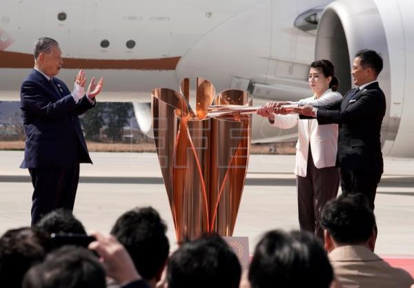 Olympic flame arrives in Japan to quiet ceremony