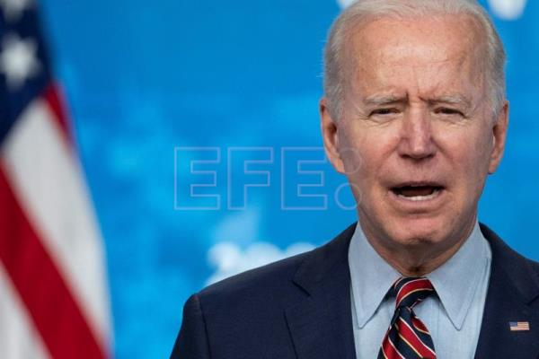 US to cut emissions in half by 2030: Biden