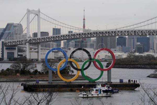 Giant Olympic rings installed in Tokyo Bay ahead of summer games