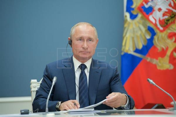 Russian President Vladimir Putin attends video conference meeting in Astana format