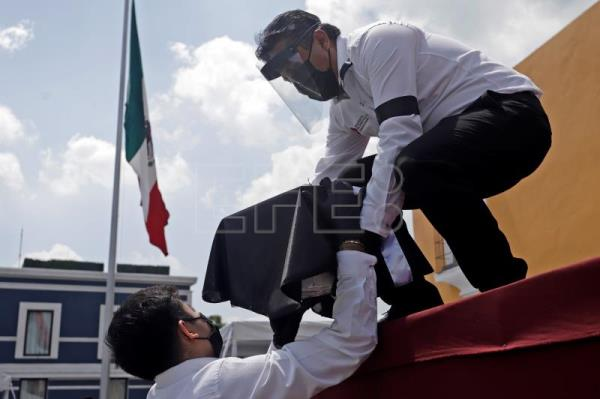 Remains of migrants who died of COVID-19 in US arrive in Puebla