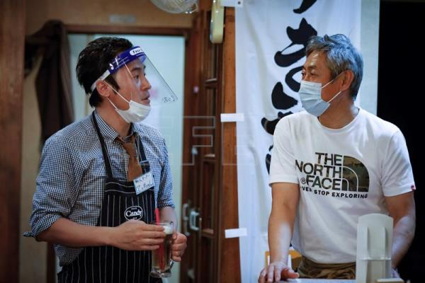 Customers dine out while wearing plastic face shields in Osaka, Japan