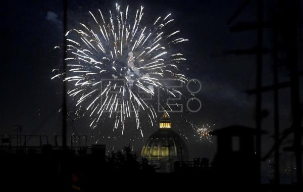 Muted New Year's celebrations bid farewell to 2020