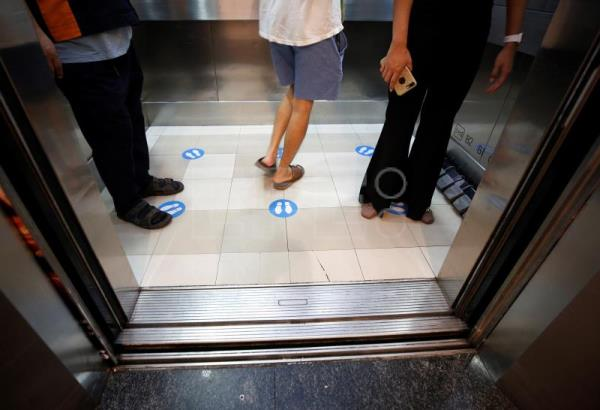 Elevators with foot pedals to fight COVID-19 in Thailand mall