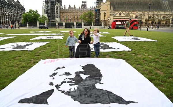 Julian Assange supporters celebrate Assange's 50th birhtday at Parliament Square in London
