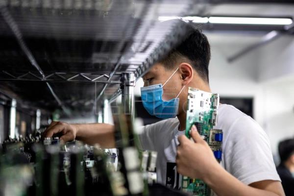 COVID-19 causes China's biggest 30-year industrial production low