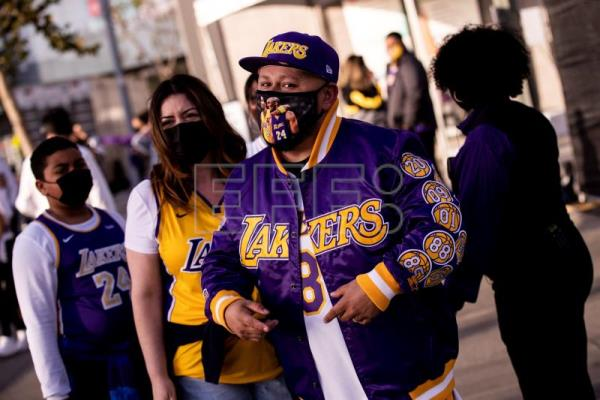 Fans arrive for Celtics vs Lakers NBA game in Los Angeles