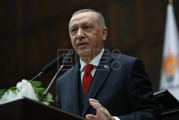 Turkish President Recep Tayyip Erdogan addresses members of the ruling Justice and Development Party (AKP)