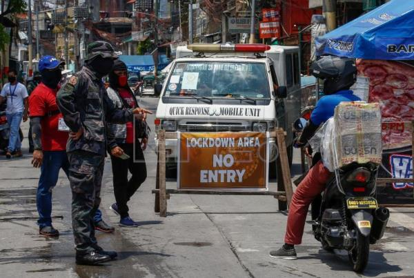 Manila struggles to handle COVID-19 despite world's longest lockdown