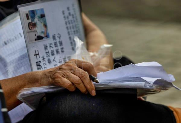 At Shanghai's Marriage Market, elders seek perfect match for their children