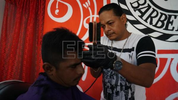 Honduran-born barber prospering in Mexico after American Dream ended