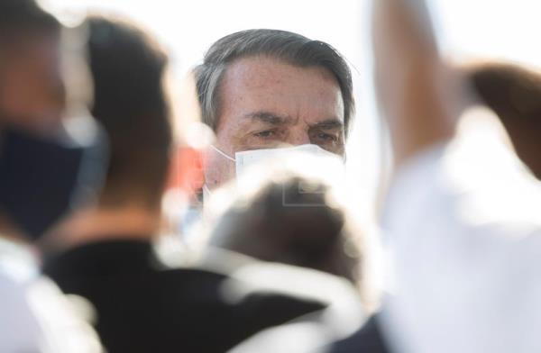 'Death is everyone's destiny,' Bolsonaro says on day of record COVID-19 toll