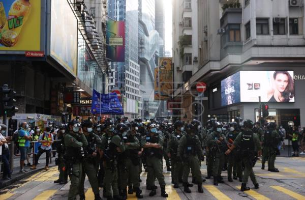 Hong Kong deploys thousands of police to prevent protests on National Day