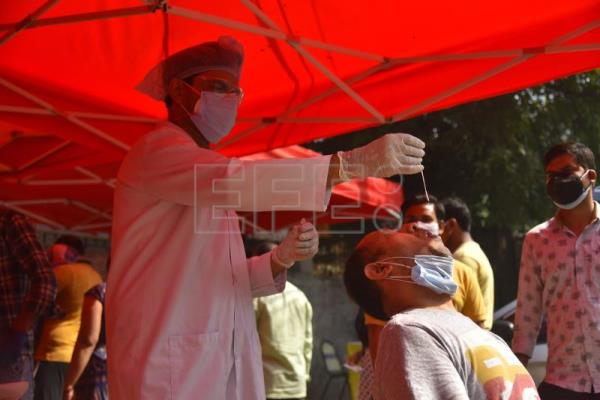 India scrambles for health resources as Covid-19 infections cross 18 million