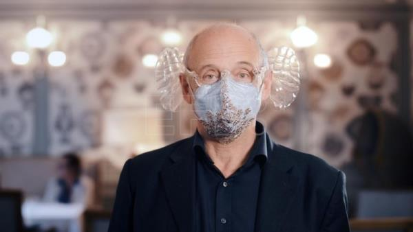 Orchestra conductor's handy mask invention boosts music enjoyment