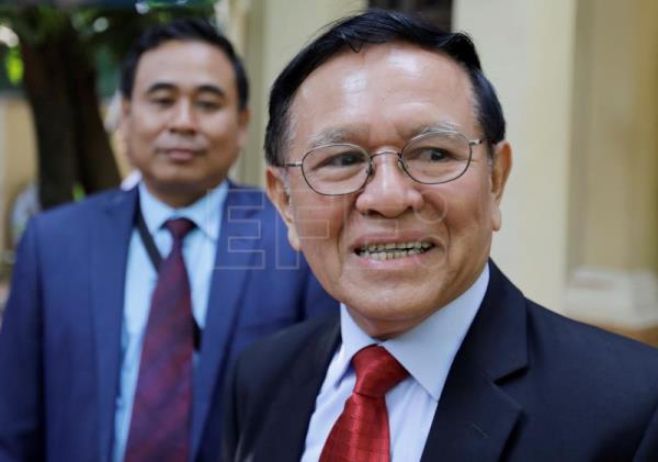 Cambodian opposition leader denies charges as treason trial begins