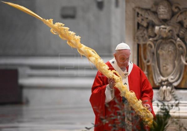 Pope holds Holy Week celebrations without faithful for first time in history