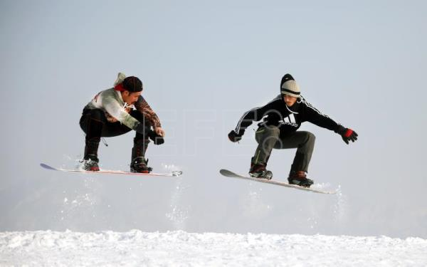 Afghans fly with snowboards to keep away from war, drugs