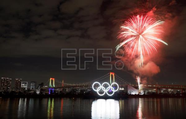 Tokyo lights up giant Olympic rings to mark six-month countdown to Games