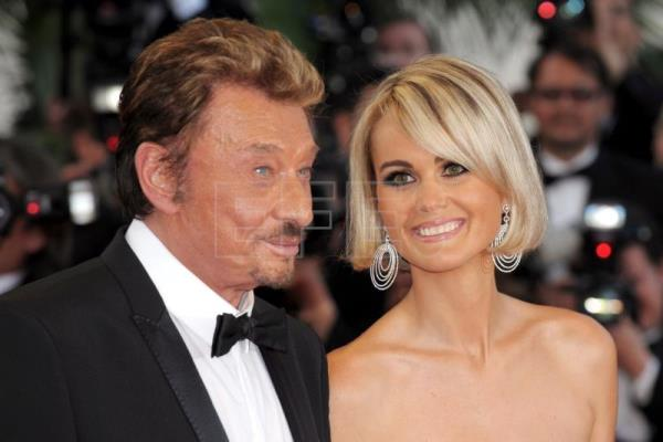 A file picture on May 17, 2009 shows French singer Johnny Hallyday (L) with his wife Laetitia arriving for the premiere of 'Vengeance' during the 62nd annual Cannes film festival in Cannes, France (reissued Dec 6, 2017).EFE-EPA/CHRISTOPHE KARABA