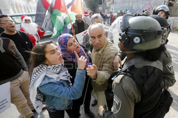 Israeli soldiers argue with Palestinian protesters during a demonstration in the West Bank city of Bethlehem, Dec. 23, 2017. EPA-EFE/ABED AL HASHLAMOUN