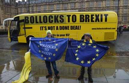 'Bollocks to Brexit' campaign bus appears before British parliament