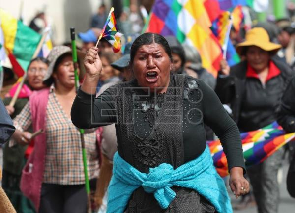 Supporters of former president of Bolivia Evo Morales march