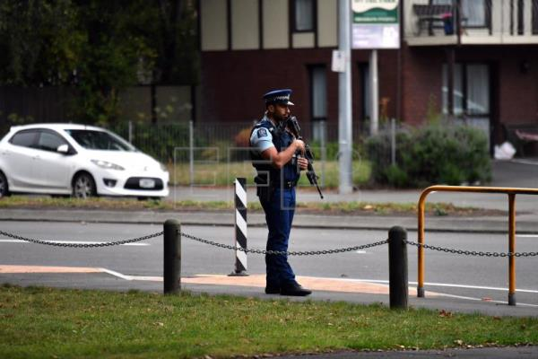 Armed police patrol across the road from the Al Noor Masjid on Deans Rd in Christchurch, New Zealand, Mar. 162019. EPA-EFE/MICK TSIKAS AUSTRALIA AND NEW ZEALAND OUT