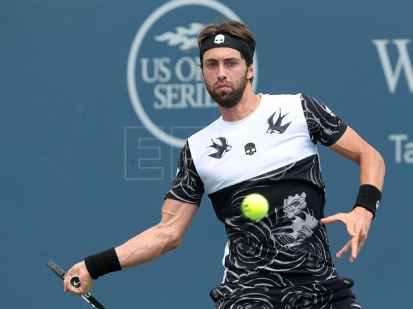 Nikoloz Basilashvili of Georgia in action against Jared Donaldson of the USA during the fourth round of the Western and Southern Open at the Lindner Family Tennis Center in Mason, Ohio, USA on August 17, 2017. EPA-EFE FILE/MARK LYONS