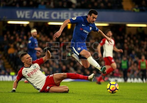 Chelsea's Pedro jumps over WBA's Kieran Gibbs during a Barclays Premier League game between Chelsea and West Bromwich Albion at Stamford Bridge London, UK, Feb. 12, 2018. EPA-EFE FILE/SEAN DEMPSEY
