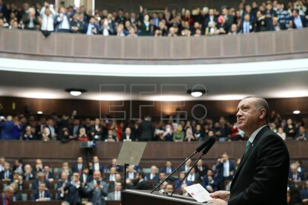 Recep Tayyip Erdogan addresses members of the ruling Justice and Development Party (AKP) at their group meeting at the parliament in Ankara, Turkey, Feb. 13, 2018. EPA/TURKISH PRESIDENTAL PRESS OFFICE HANDOUT