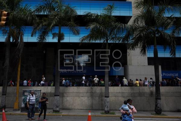 A photograph dated Nov. 2, 2017, showing a group of people waiting in line to enter a bank in Caracas, Venezuela. EPA-EFE/Miguel Gutierrez