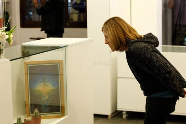 A woman observes objects that are exhibited during the inauguration of the first Cannabis Museum of South America in Montevideo, Uruguay, 08 December 2016. EPA/ Raul Martinez