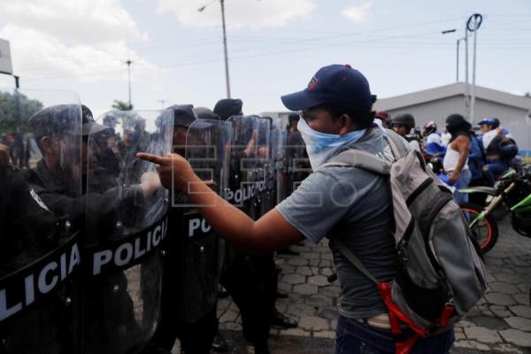 Protesters face off with riot police during a march named 'Rescue the Homeland' in protest against President Daniel Ortega in Managua, Nicaragua, on 16 September 2018. EPA-EFE/Esteban Biba