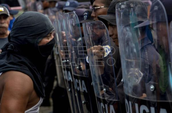 Demonstrators face riot police during a march named 'Rescue the Homeland' in protest against President Daniel Ortega in Managua, Nicaragua, on 16 September 2018. EPA-EFE/Jorge Torres