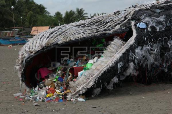 A handout photo made available by Greenpeace-Philippines shows an art installation depicting a dead whale choked by plastic and trash lying along the coast of Naic township, Cavite province, Philippines, 11 May 2017 (issued 12 May 2017).  EPA/GREENPEACE-PHILIPPINES HANDOUT HANDOUT EDITORIAL USE ONLY/NO SALES