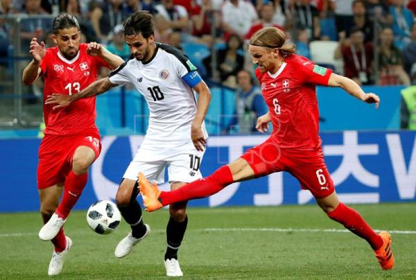 Bryan Ruiz (C) of Costa Rica in action against Switzerland during a World  Cup b215d9e65