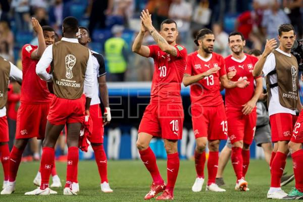 Switzerland celebrate advancing to the 2018 World Cup knockout stage after  drawing 2-2 with 55c5f0c71