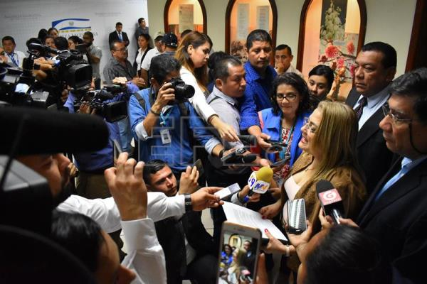 Photograph showing ombud of El Salvador Raquel Caballero as she talks to reporters regarding the approval of a controversial water law that opponents see as aimed at opening the door to privatization in San Salvador, El Salvador, Jun 27, 2018. EPA-EFE/Armando Escobar