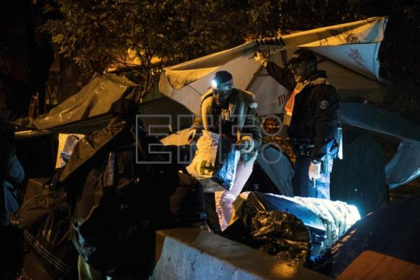 Police clear 2 makeshift migrant camps outside Paris